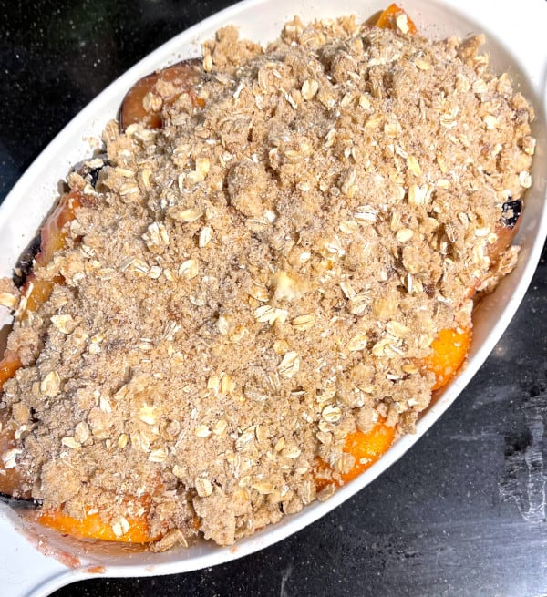 Assembled vegan fruit crisp in baking dish before baking