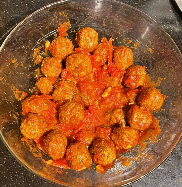 Vegan meatballs mixed with marinara sauce