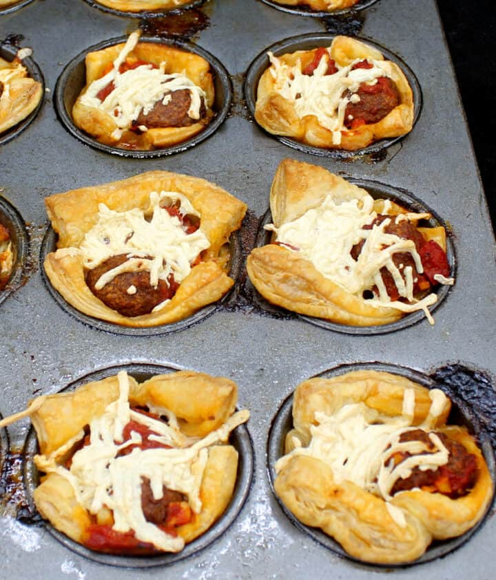 Baked puff pastry cups in muffin tin