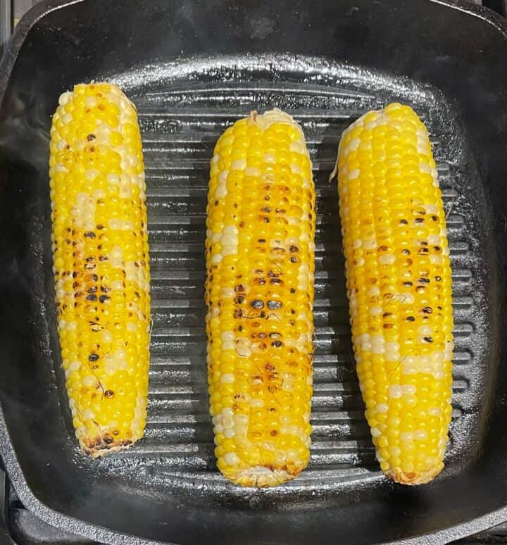 Corn roasting on a grill pan