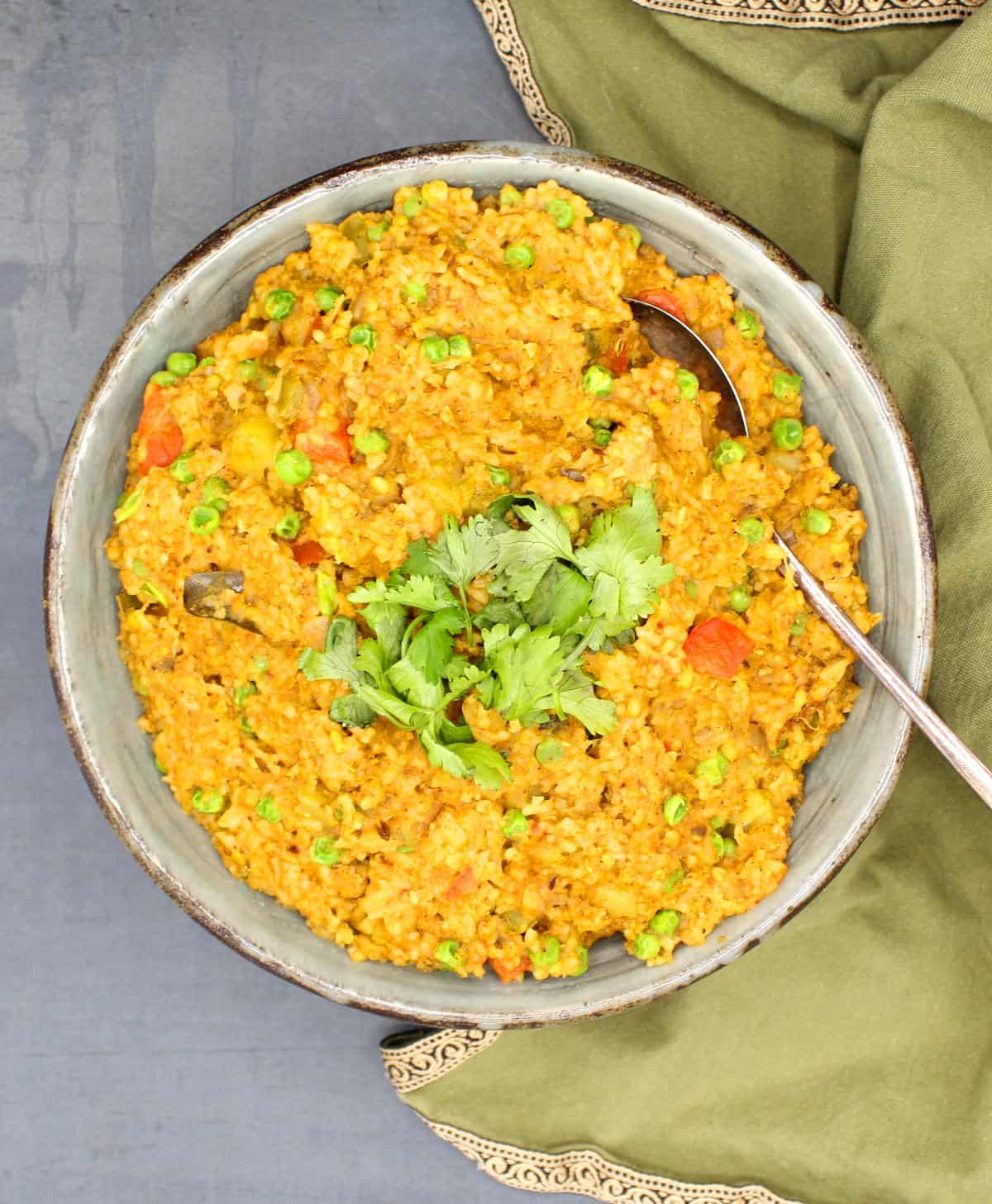 Overhead shot of a large bowl with khichdi and cilantro garnish.