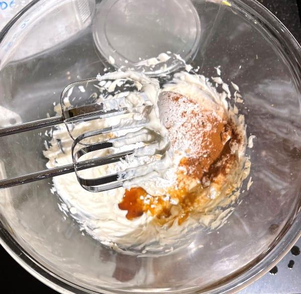Vegan cream cheese glaze ingredients with beaters