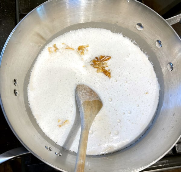 Cashew milk added to the pot with caramel