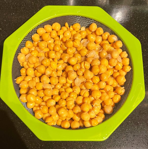 Boiled or canned chickpeas in colander