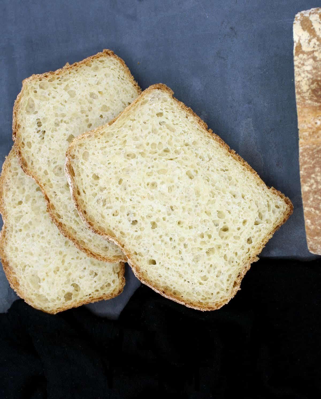 Overhead photo of three slices of crusty homemade bread.