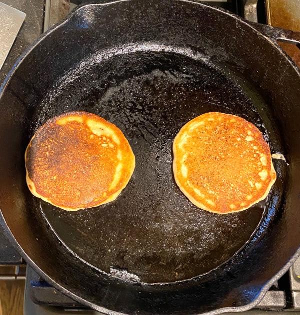 Vegan lemon pancakes cooking on skillet
