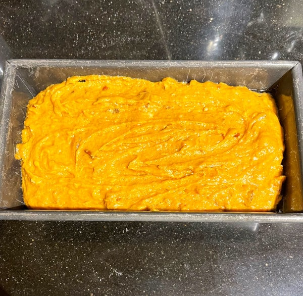 Vegan pumpkin bread batter in loaf pan