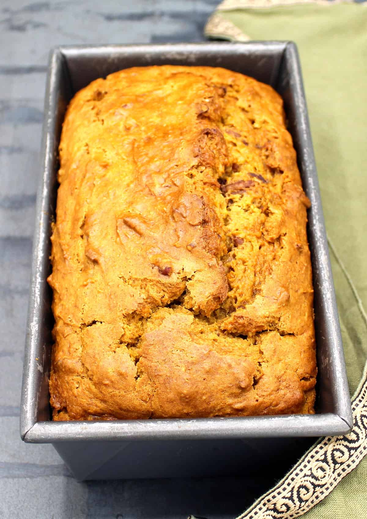 Pumpkin bread fresh out of the oven in loaf pan.