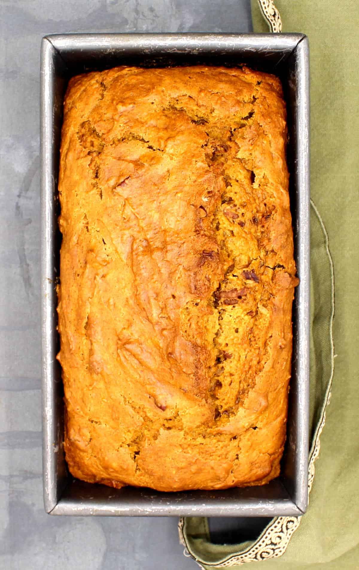 Overhead shot of vegan pumpkin bread in loaf pan.
