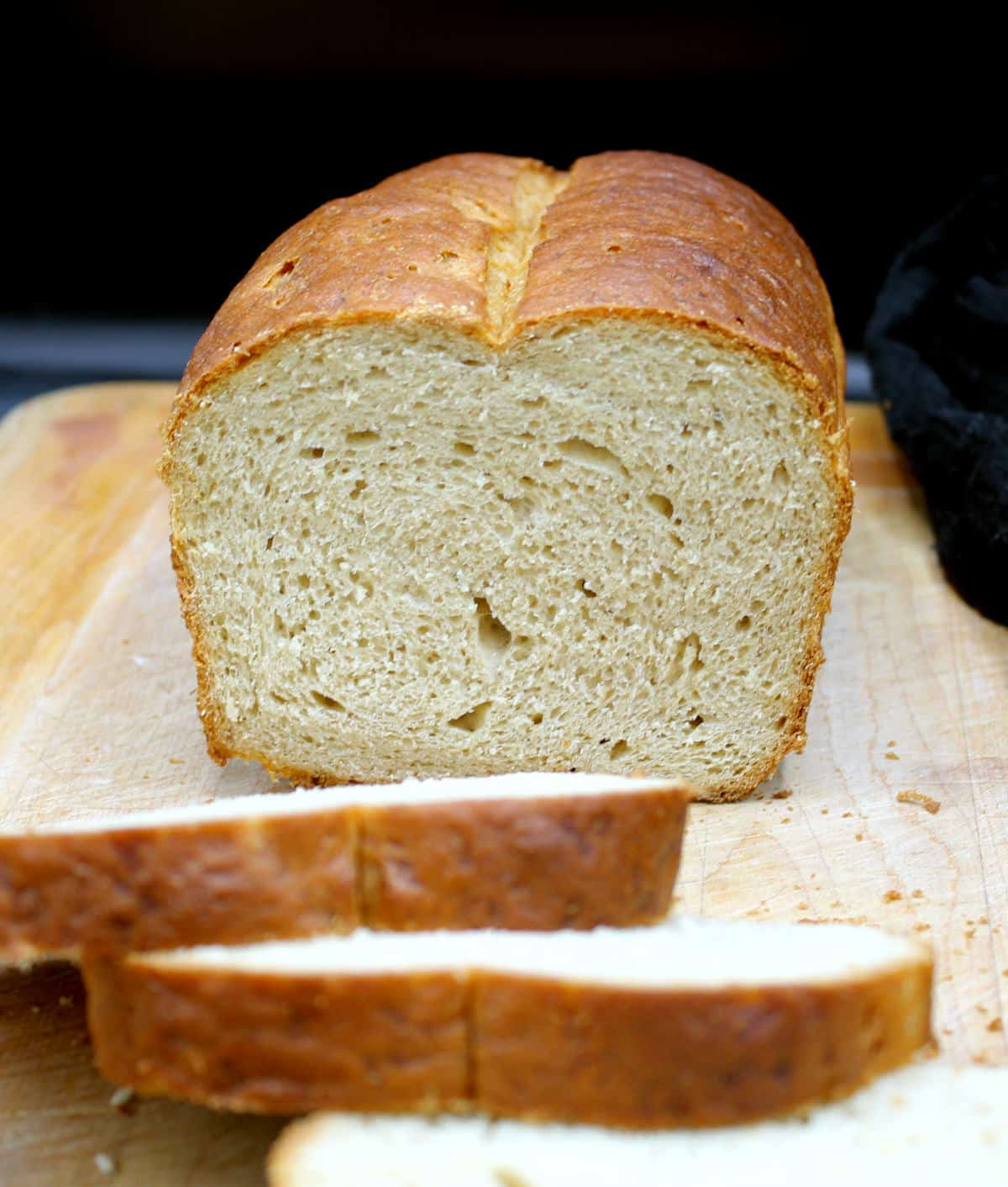 Front photo of a loaf of whole wheat sandwich bread showing the light, airy crumb.